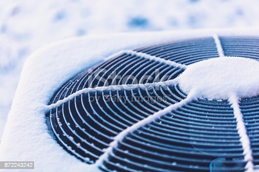 istock Air conditioning unit covered in snow 872243242