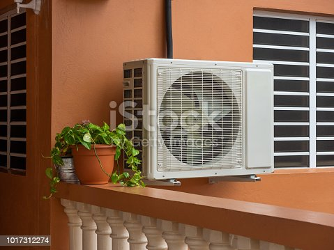 istock Air conditioning unit outside a house 1017312274