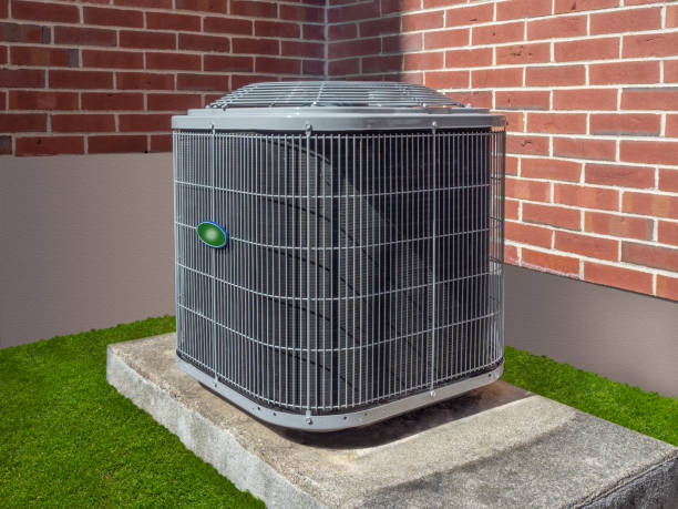 Air conditioning unit outside an apartment complex stock photo