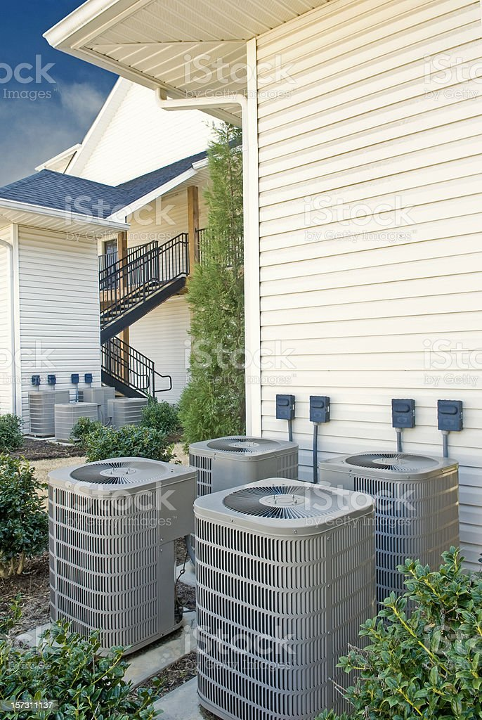 Air Conditioning Units For A Multi-Family Apartment Building (Vertical) royalty-free stock photo