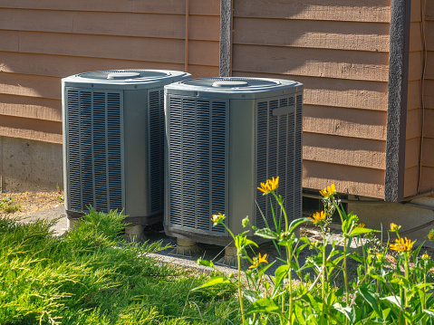 High efficiency modern AC-heater inverter units, energy save solution-horizontal, outside an apartment complex