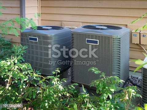 istock Air conditioning units outside an apartment complex 1017312392