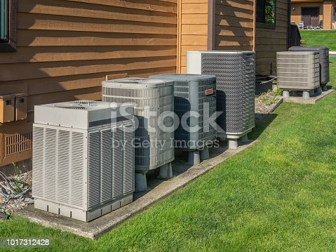 istock Air conditioning units outside an apartment complex 1017312428