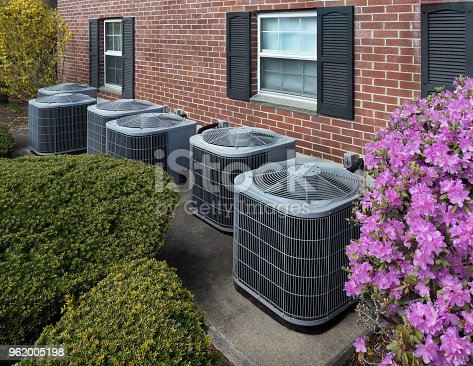 istock Air conditioning units outside an apartment complex 962005198