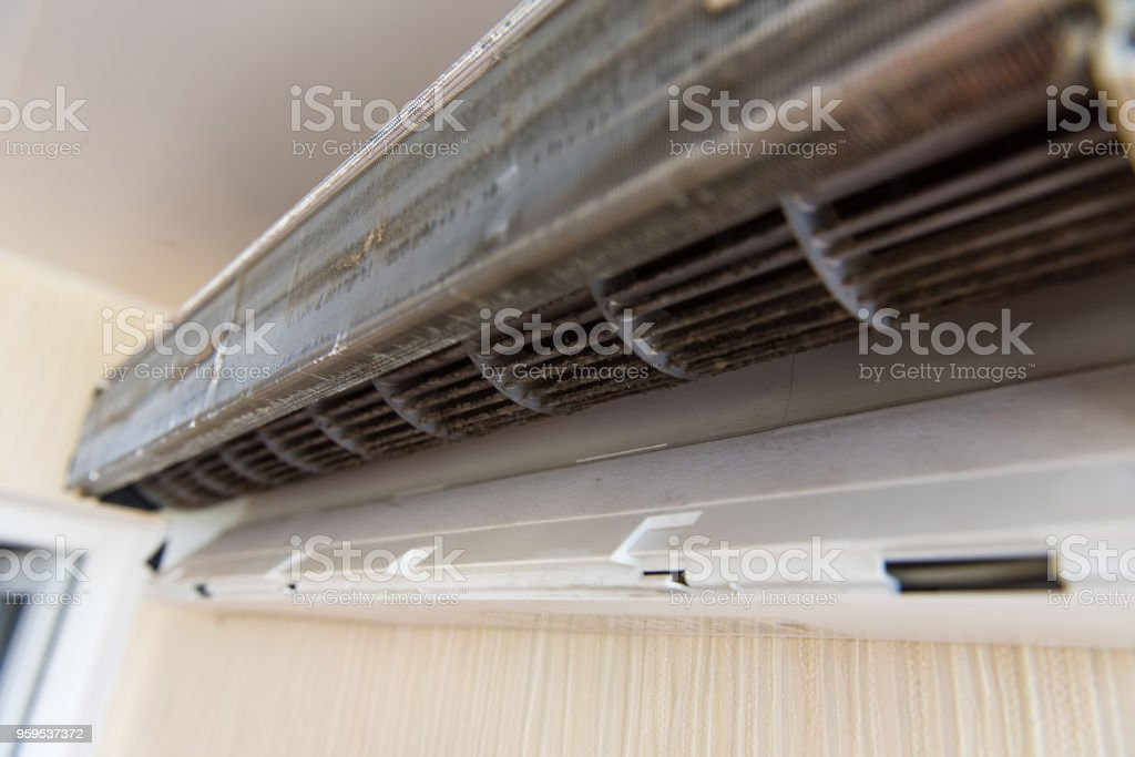 Air conditioning without front panel on wall stock photo