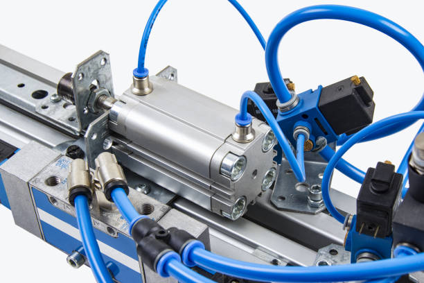air cylinder Details from an automated industrial plant in the field of compressed air technology. mechanical engineering stock pictures, royalty-free photos & images