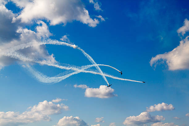 air dogfight on airshow - airshow stock photos and pictures