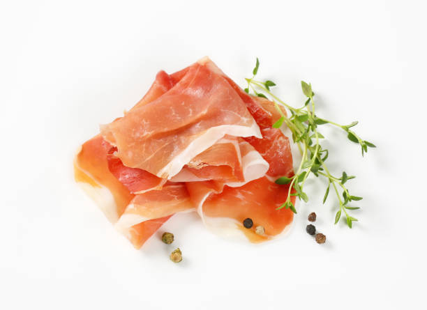 air dried ham with thyme and pepper stock photo
