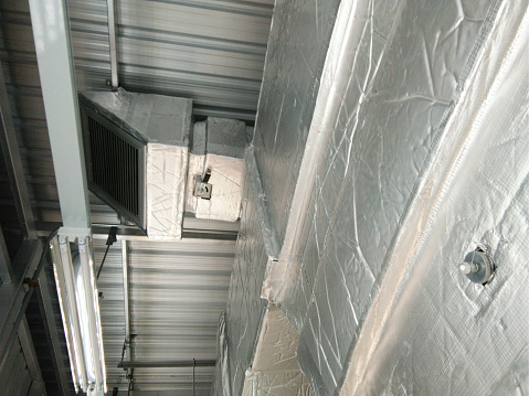 Air duct and ventilation systems. Ventilation pipes in silver insulation material