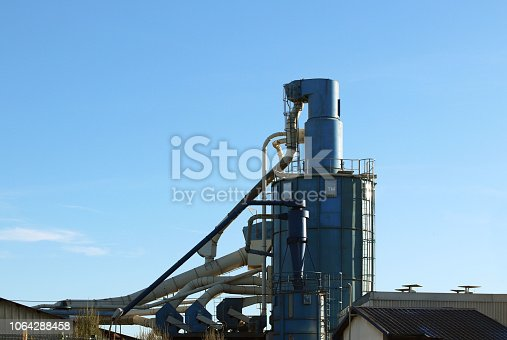 istock Air duct pipe and roof for industrial with blue sky background. 1064288458