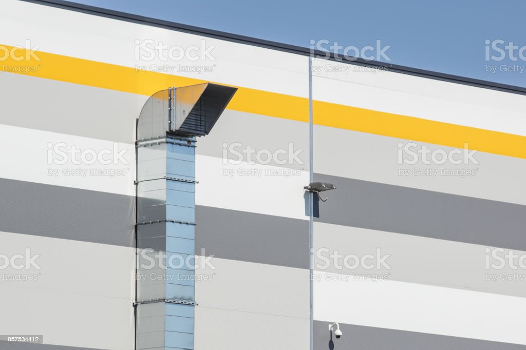 Air Ducts in a row on a building rooftop. stock photo