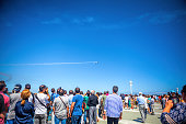 Gijon, Asturias, Spain-July 22, 2018: Spectators watch the flight of aircraft during the air festival 2018 in Gijon