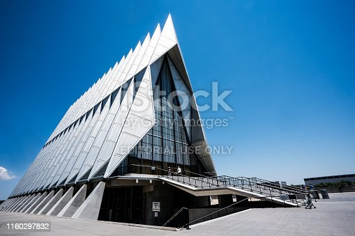 Colorado, USA - July 7, 2018: Tourists enter the modern architectural chapel at the Air Force Academy, the number one attraction in the state, Colorado Springs, Colorado, USA