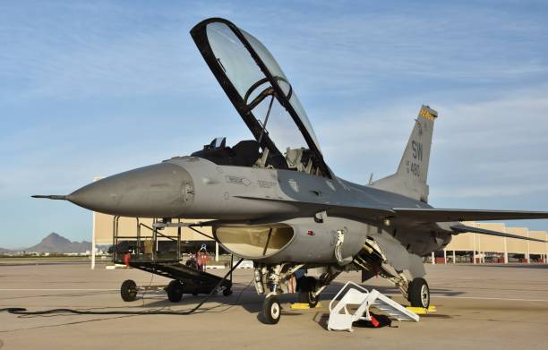 Air Force F-16 Viper/Fighting Falcon Tucson, USA - March 2, 2018: An Air Force F-16 Viper/Fighting Falcon on the runway at Davis-Monthan Air Force Base. This F-16 with its canopy open belongs to Shaw Air Force Base. f 16 fighting falcon stock pictures, royalty-free photos & images