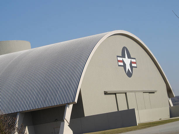 Air Force Hanger Side view of an Air Force hanger with doors closed and insigia visible. military base stock pictures, royalty-free photos & images