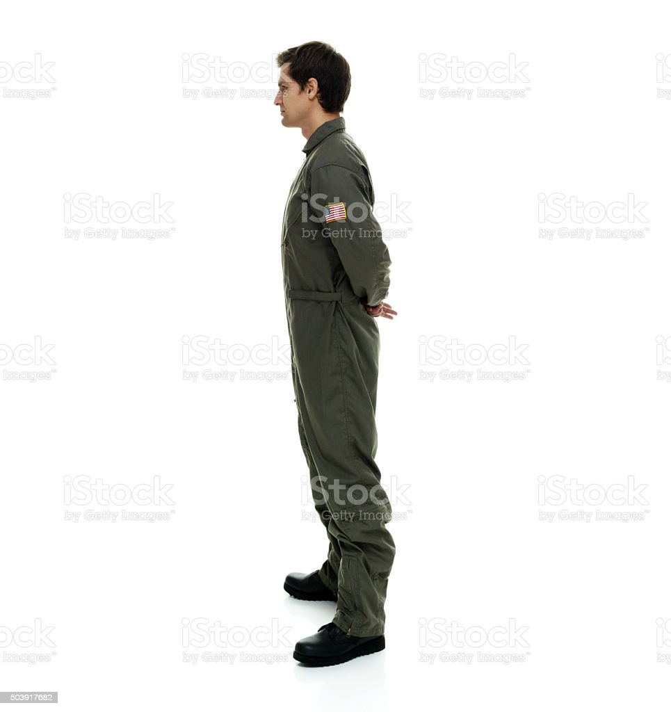 Air force pilot standing and looking away stock photo