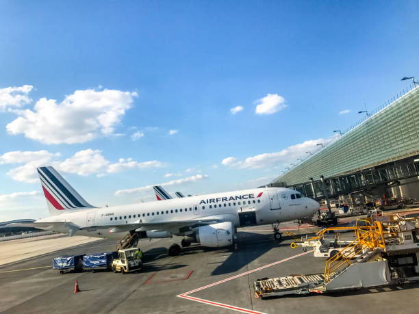 Air France Airplane at Charles de Gaulle Airport, Paris, France Paris, France - April 29, 2017: Air France airplanes parked at the gate of Roissy Charles de Gaulle Airport. val d'oise stock pictures, royalty-free photos & images