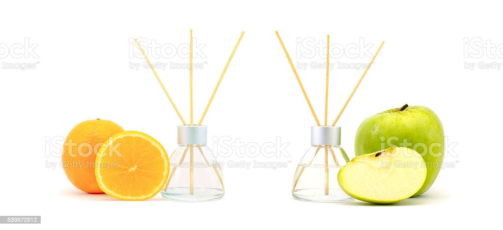 Air freshener sticks with a green apple and orange isolated stock photo
