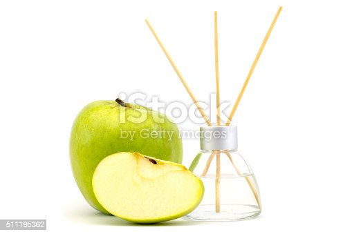 air freshener sticks with a green apple isolated on white background