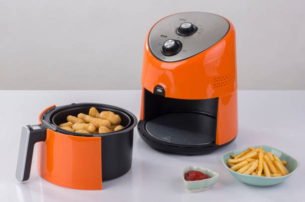 air fryer machine - blowing stock photos and pictures