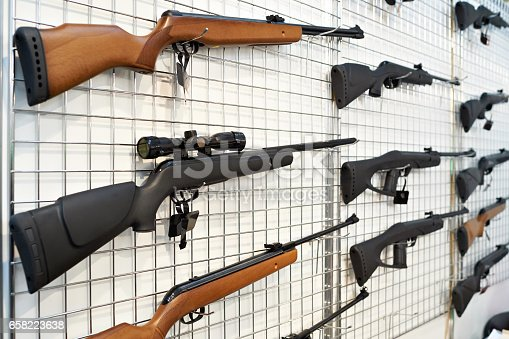 istock Air guns on stand in shop 658223638
