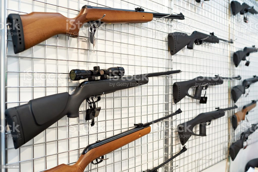 Air guns on stand in shop stock photo