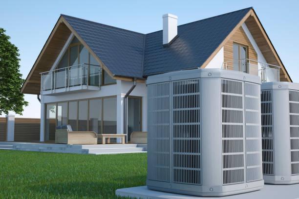 Luftwärmepumpe und Haus – Foto