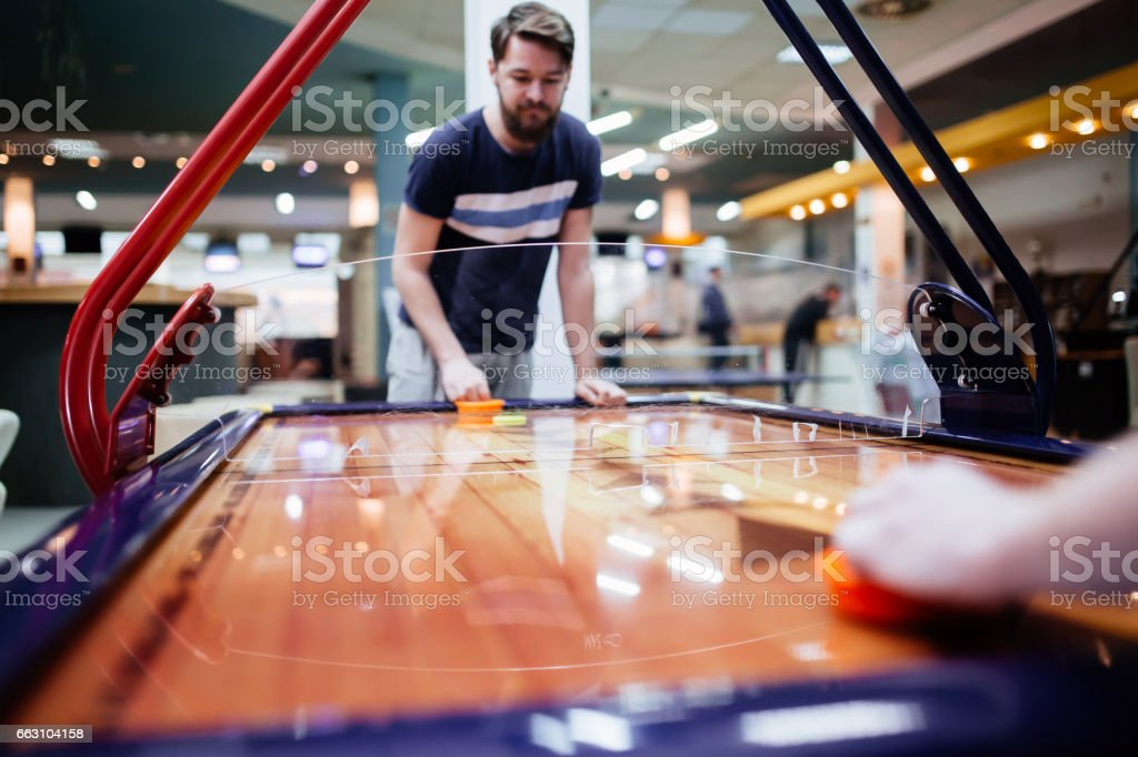 Air hockey game  is fun even for adults stock photo