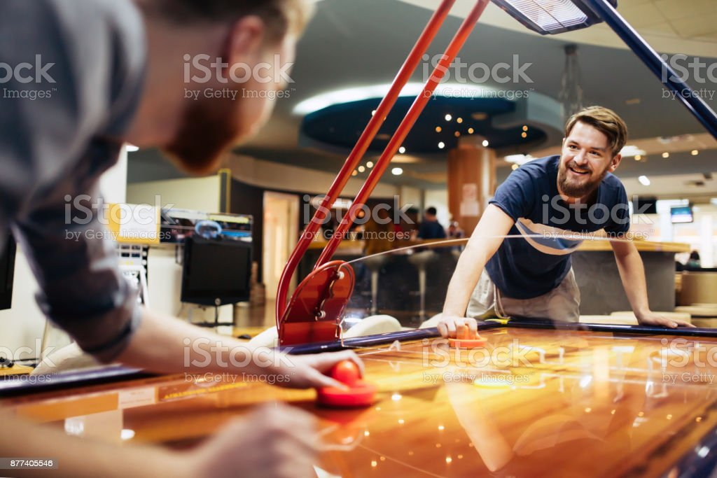 Air hockey is fun even for adults stock photo