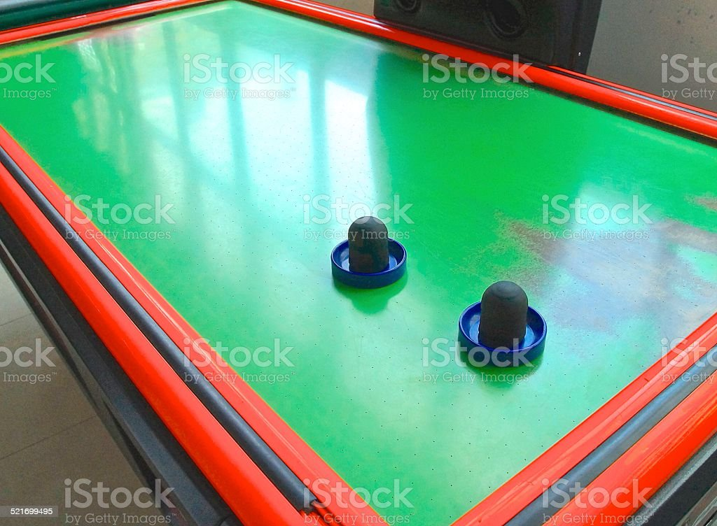Air hockey table closeup with paddle stock photo