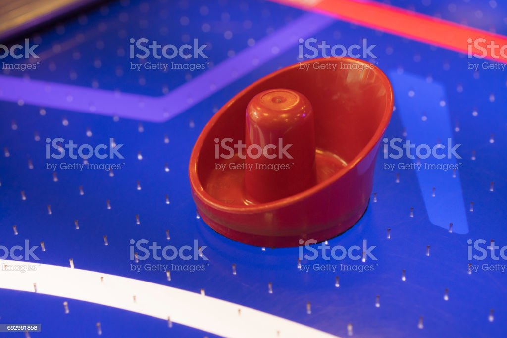 Air Hockey Table Paddle On Red Blue And White stock photo