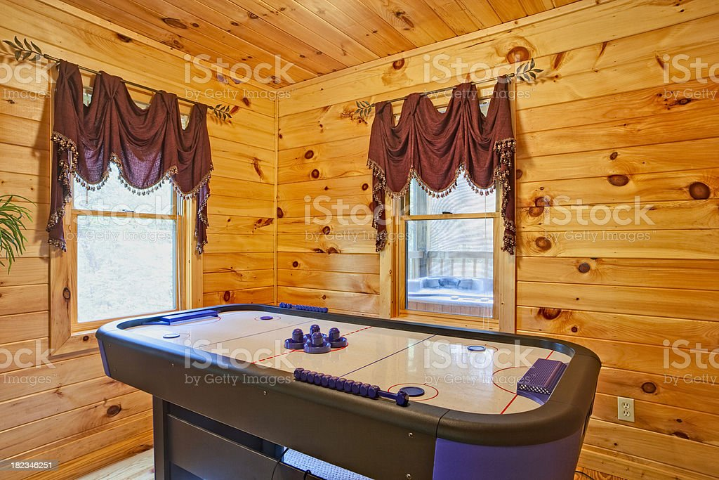 Air hocky in the log cabin game room royalty-free stock photo