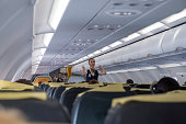 Antalya, Turkey - August 21,2018 :Pegasus Airlines  stewardess give security instructions to the passengers before Antalya - Istanbul flight, Turkey