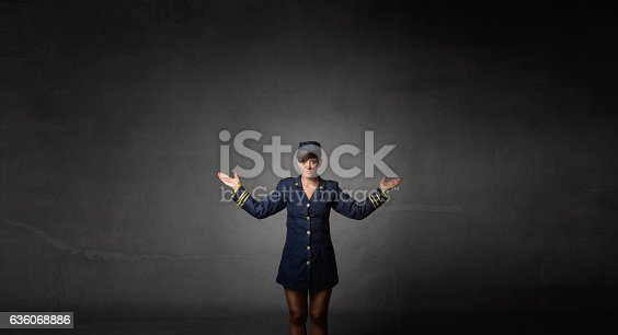istock air hostess showing exit 636068886