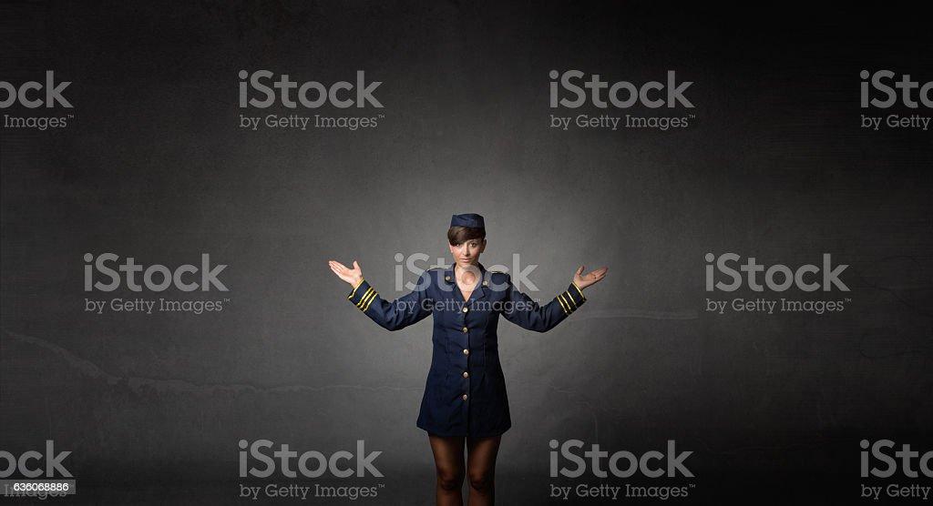 air hostess showing exit – Foto