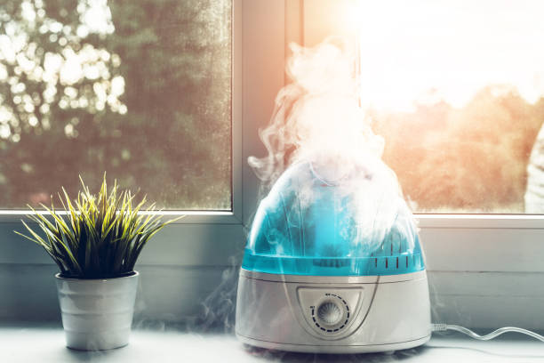 air humidifier during work. - wind stock pictures, royalty-free photos & images