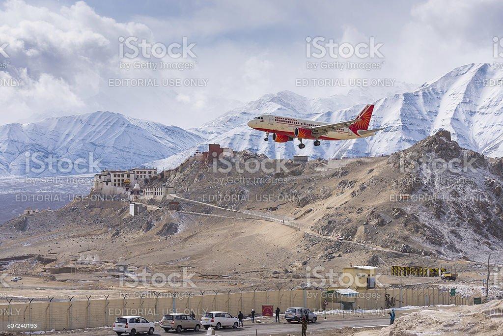 Air India plane landing passing monastery stock photo