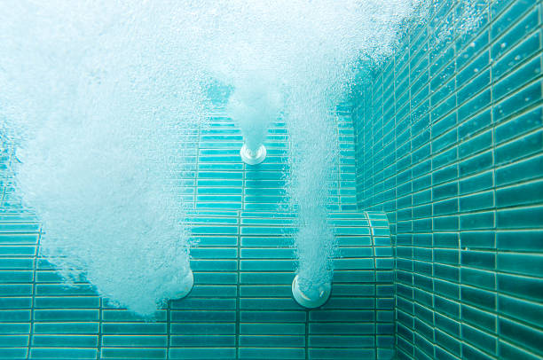 air jet in swimming pool - competition group stock photos and pictures
