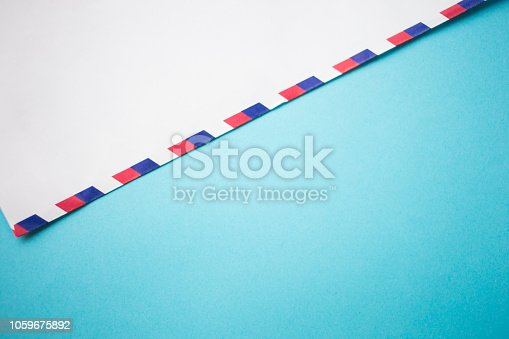 istock air mail envelope letter on blue background 1059675892