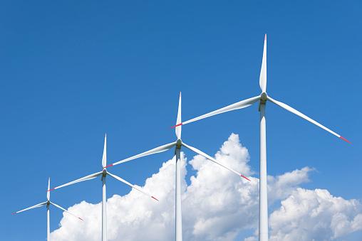 Air mills power station against the sky. Alternative energy