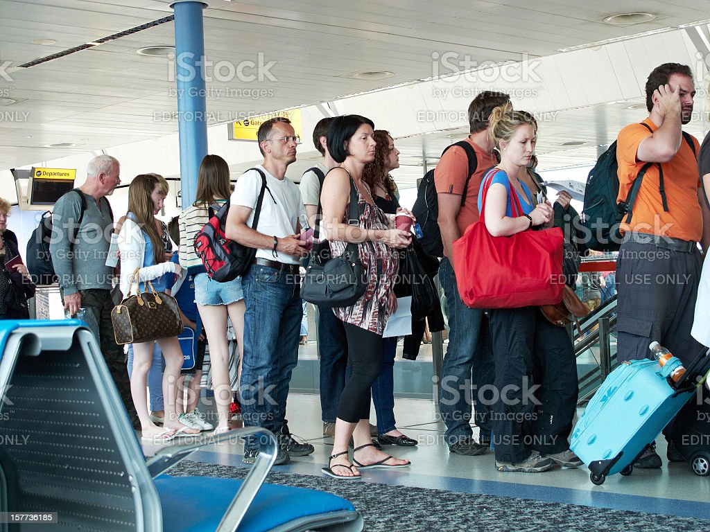 Air passengers queuing at the gate stock photo