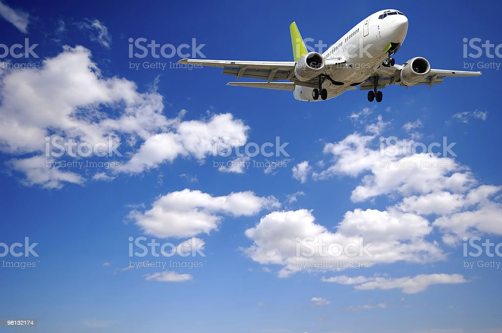 Air plane and clouds royalty-free stock photo