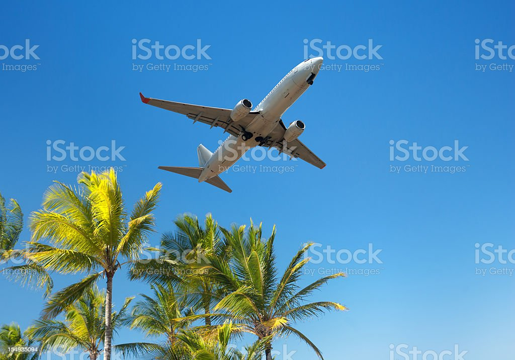 Air plane to tropical summer beach vacation royalty-free stock photo