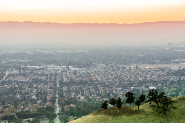 air polluted silicon valley sunset. - skyline mountains usa stock photos and pictures