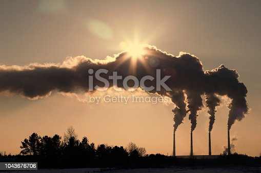 istock Air pollution clouds of smoke coming from the chimneys 1043676706