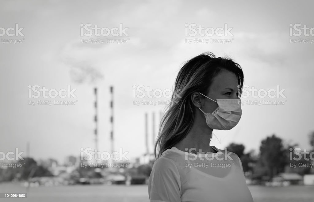 Air pollution, ecology concept. Portrait of man wearing facial hygienic mask outdoors. Ecology, air pollution, Environmental awareness concept stock photo