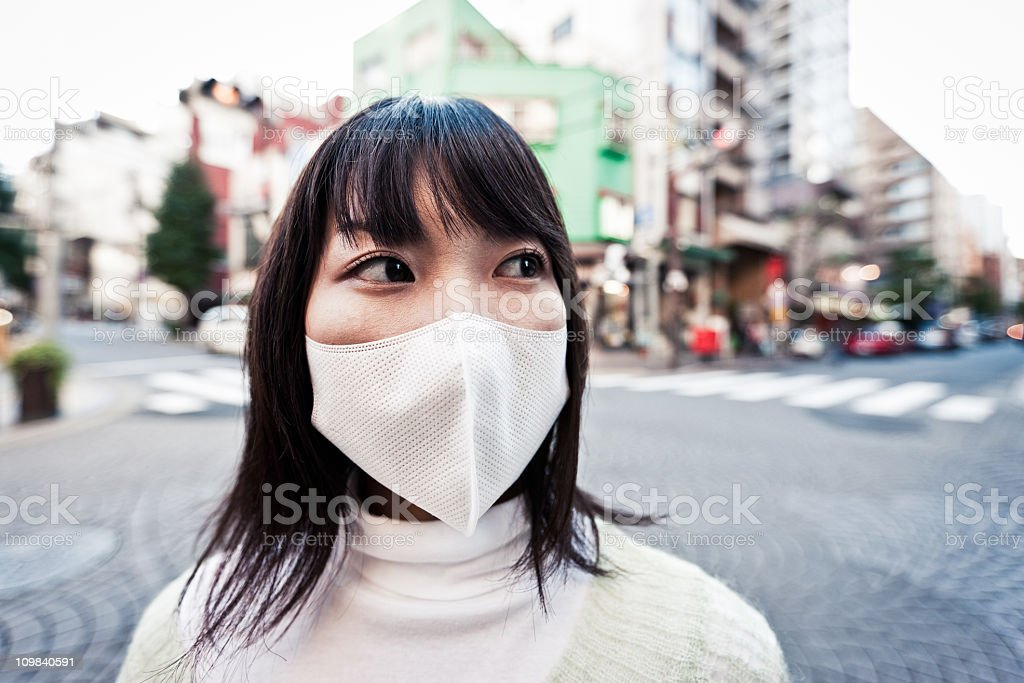 Air Pollution Facial Mask Urban Woman Portrait stock photo