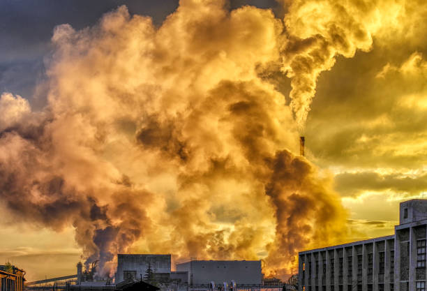 Air pollution from chimney in factory stock photo