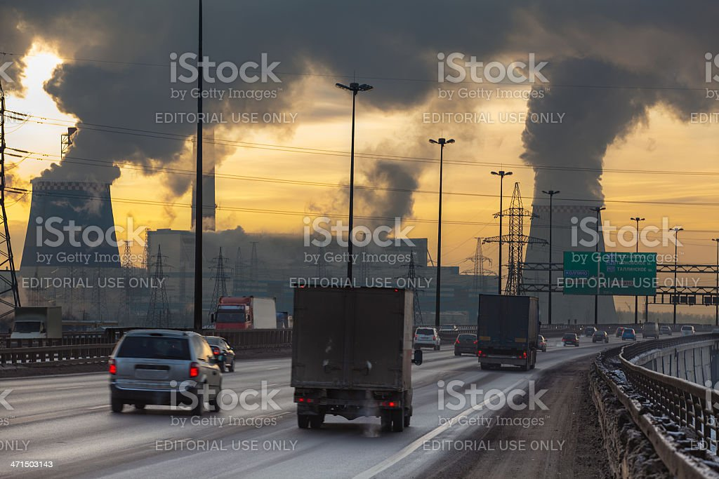 Air pollution from factory with cars on road stock photo