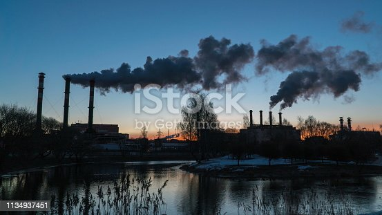 istock Air pollution from industrial plant pipes 1134937451